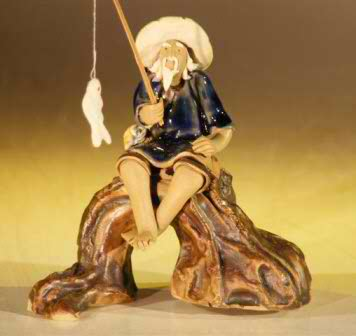 Miniature Ceramic Fisherman Figurine Fisherman Sitting On A Log