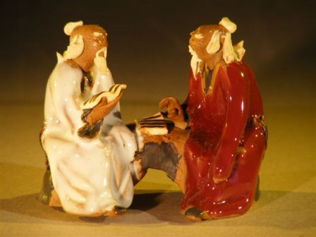 Miniature Glazed Figurine Two Men Sitting on a Bench