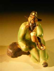 Ceramic Miniature Figurine Man on Bench Holding Drinking Cup